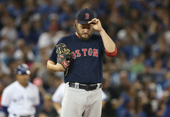 TORONTO, CANADA - MAY 8: Wade Miley #20 of the Boston Red Sox in the sixth inning during MLB game action against the Toronto Blue Jays on May 8, 2015 at Rogers Centre in Toronto, Ontario, Canada. (Photo by Tom Szczerbowski/Getty Images)