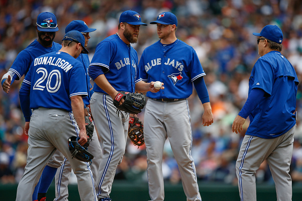 SEATTLE, WA - JULY 26:  Starting pitcher Mark Buehrle #56 of the Toronto Blue Jays is removed from the game by manager John Gibbons #5 in the sixth inning against the Seattle Mariners at Safeco Field on July 26, 2015 in Seattle, Washington.  (Photo by Otto Greule Jr/Getty Images)